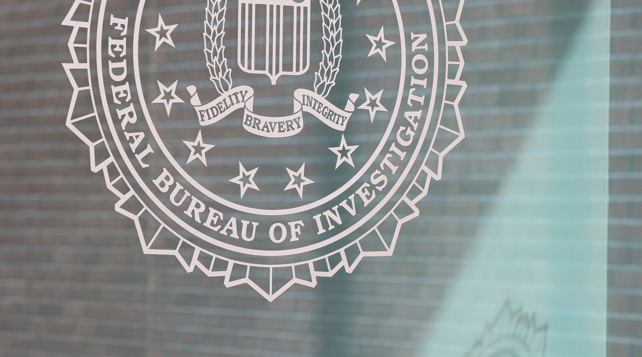 The FBI logo on the outside of a building