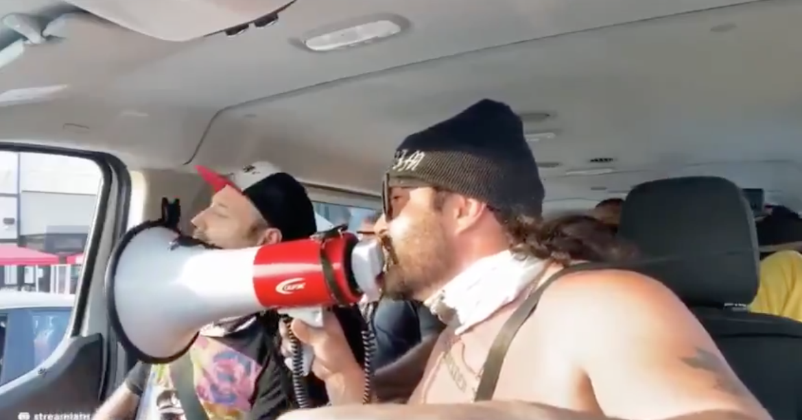 Screenshot of a video posted on Aug. 23 on Goyim TV of Jon Minadeo shouting at people on the street in Los Angeles through a megaphone.