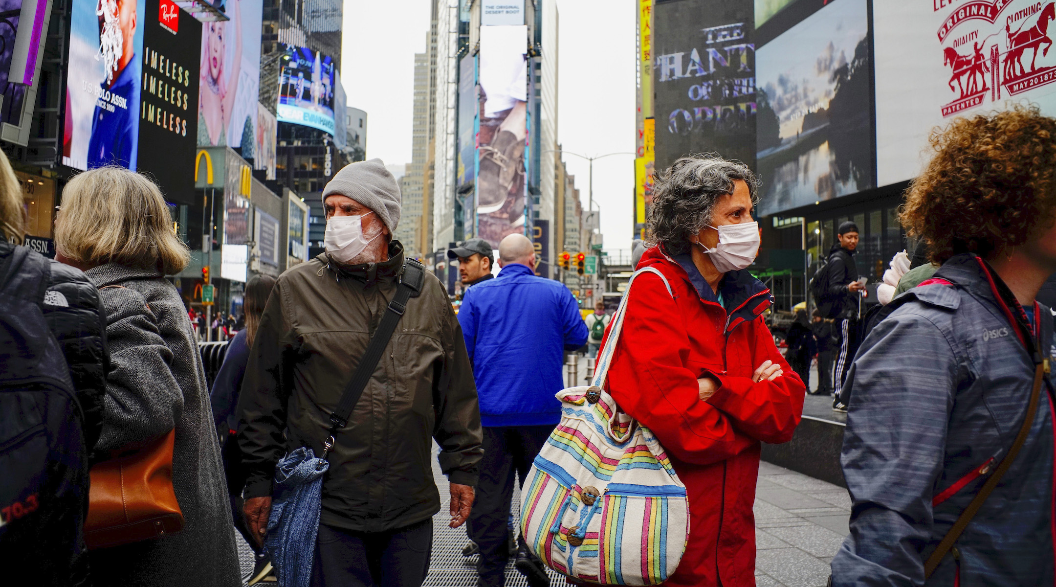 People wear face masks in Times Square in New York City, March 3, 2020, after the city confirmed cases of the rapidly spreading coronavirus. (Photo/JTA-Eduardo Munoz-VIEWpress via Getty Images)