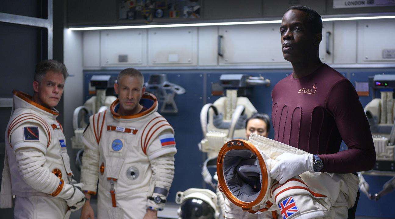 "Ato Essandoh (right) as Kwesi Weisberg-Annan in Netflix's space drama ""Away."" (Photo/JTA-Diyah Pera-Netflix)"