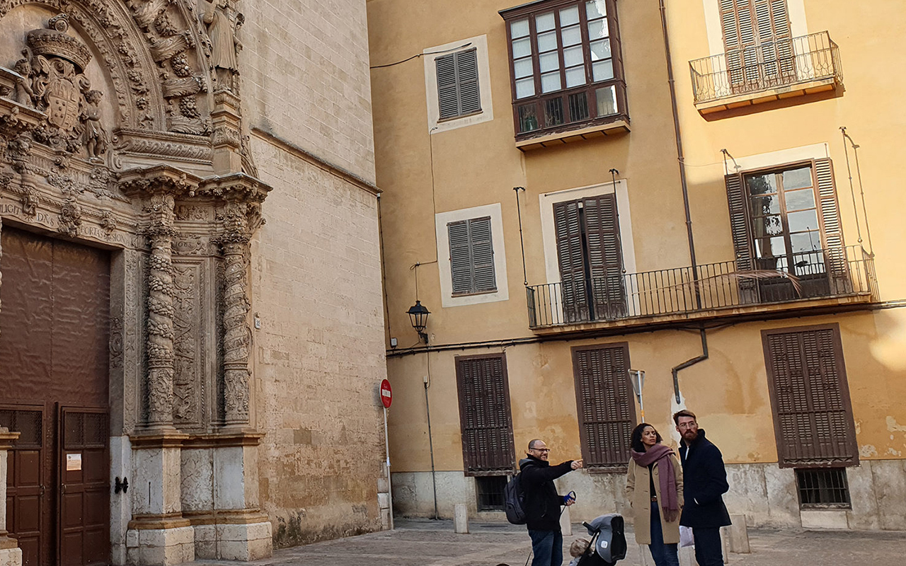 Dani Rotstein, pointing, explains to German tourists about a church that used to be a synagogue in Palma de Mallorca, Spain, Feb. 11, 2019. (Photo/JTA-Cnaan Liphshiz)