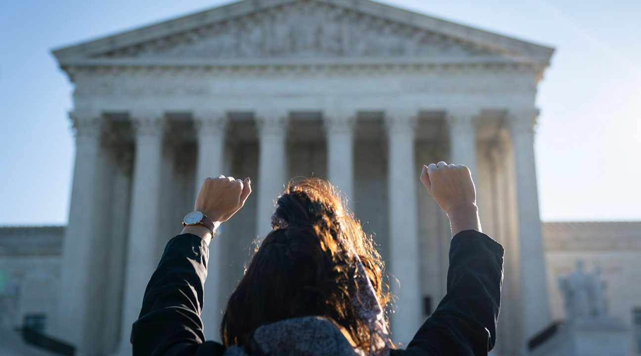 A woman with the pro-life organization Bound4Life raises her hands in prayer outside of the U.S. Supreme Court building, Oct. 5, 2020. (Photo/JTA-Drew Angerer-Getty Images)