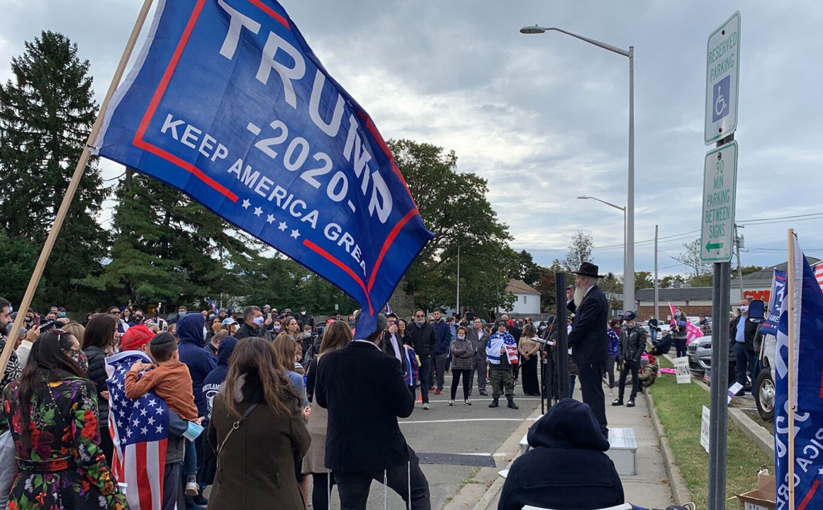 Rabbi Yitzchak Smith, a rabbi and lawyer who has has recently gained a following by promoting the idea that Covid-19 testing is a government ploy to hurt Orthodox Jews, addressed a rally in support of Donald Trump and religious freedom in Long Island Sunday. (Photo/JTA-Shira Hanau)