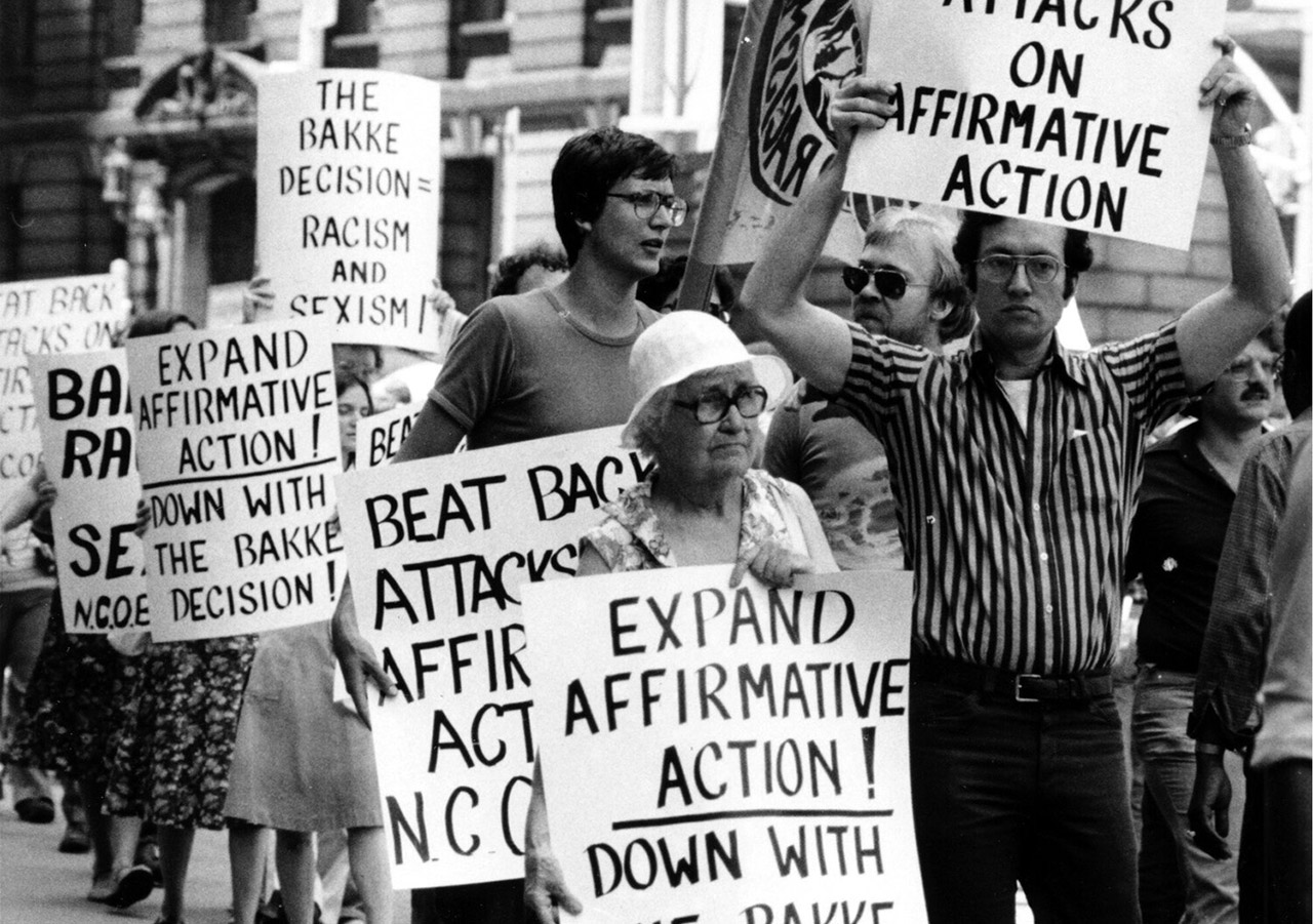 Pro-affirmative action protesters carry signs about Regents of the University of California v. Bakke, a Supreme Court case regarding affirmative action at UC Davis, as they march before the federal court house in Foley Square in New York City on June 30, 1978. (Photo/AP)