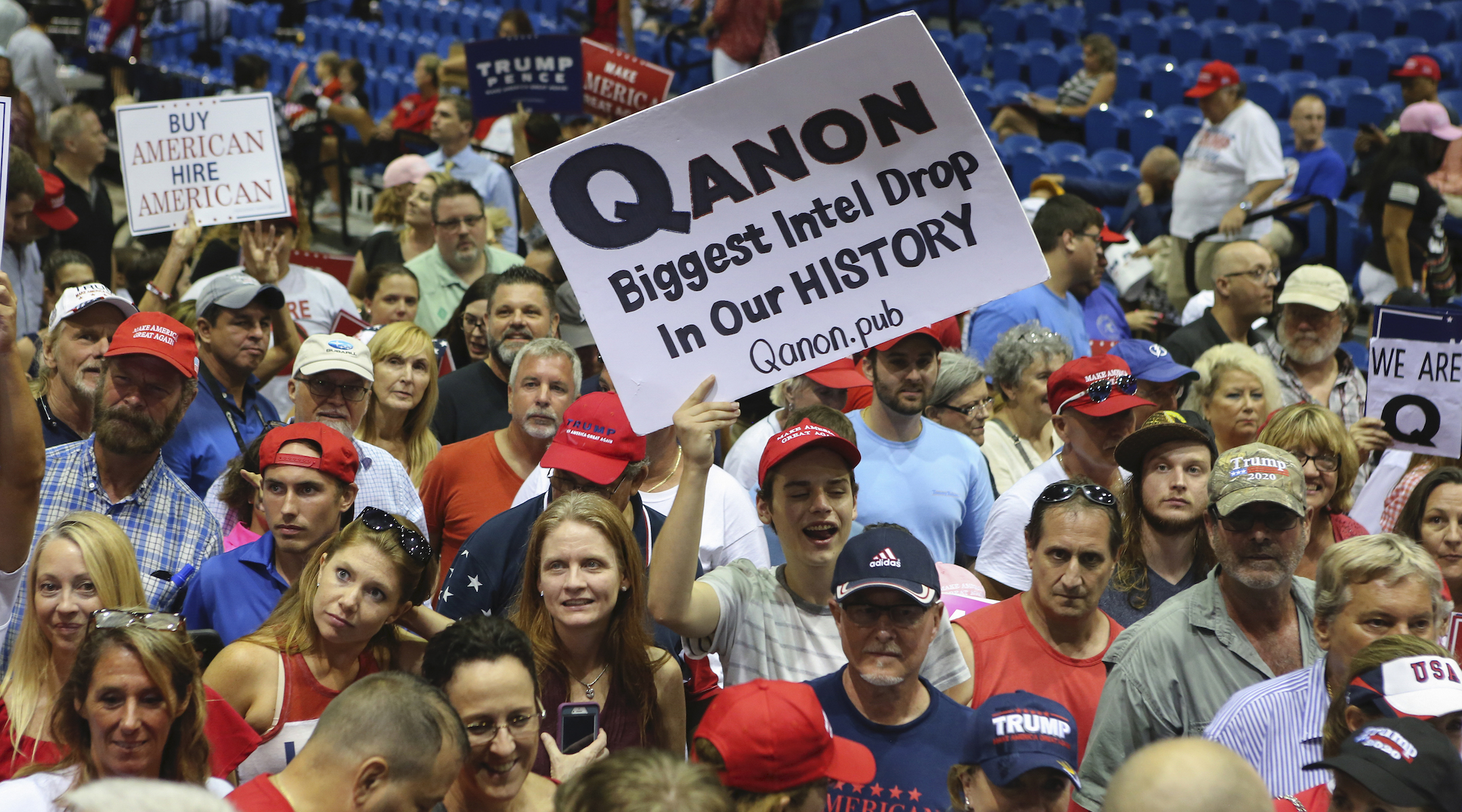 A Trump supporter displays a pro-QAnon poster at a 2018 rally in Florida. (Photo/JTA-Thomas O'Neill-NurPhoto via Getty Images)