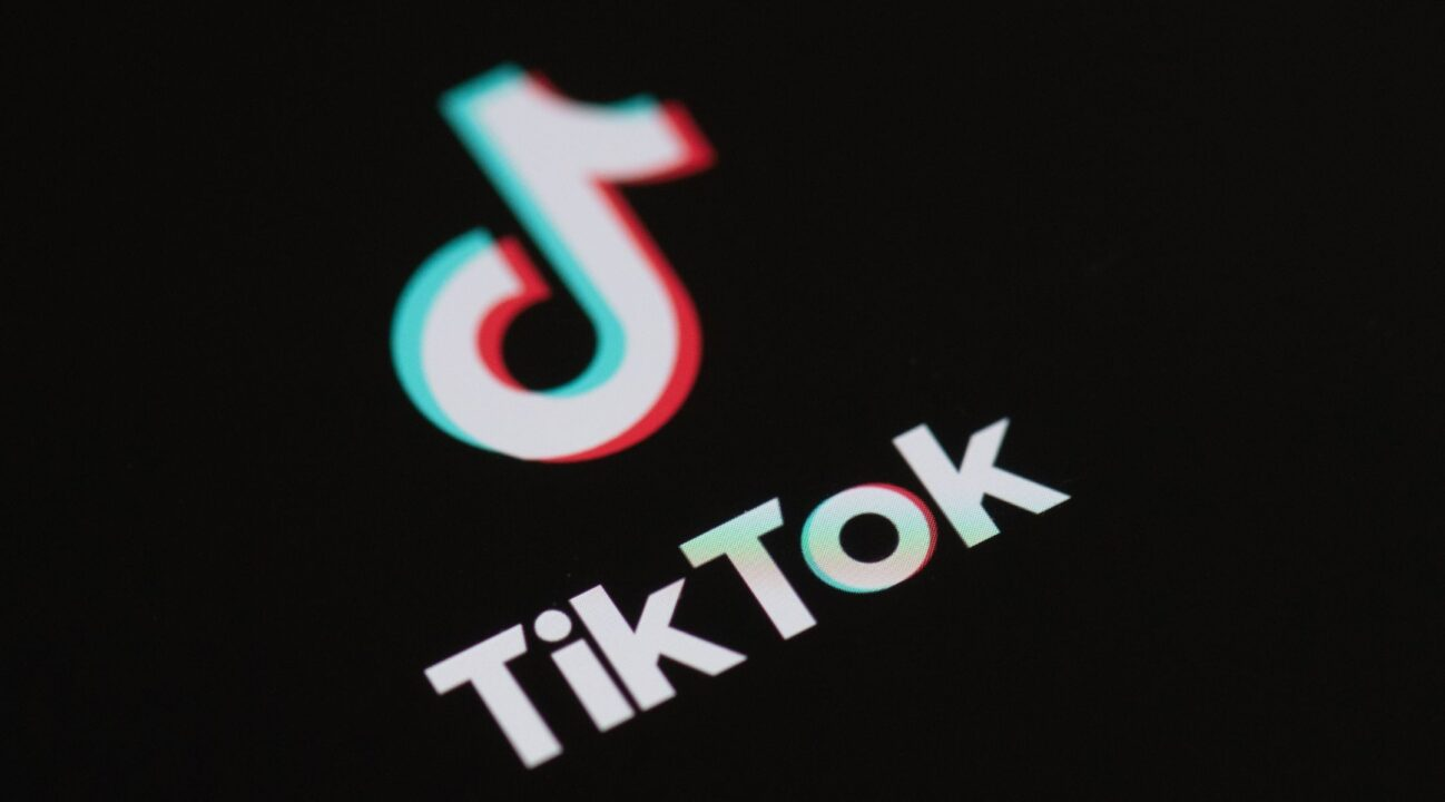 Logo of the social network application TikTok on the screen of a phone. (Photo/JTA-Martin Bureau-AFP via Getty Images)