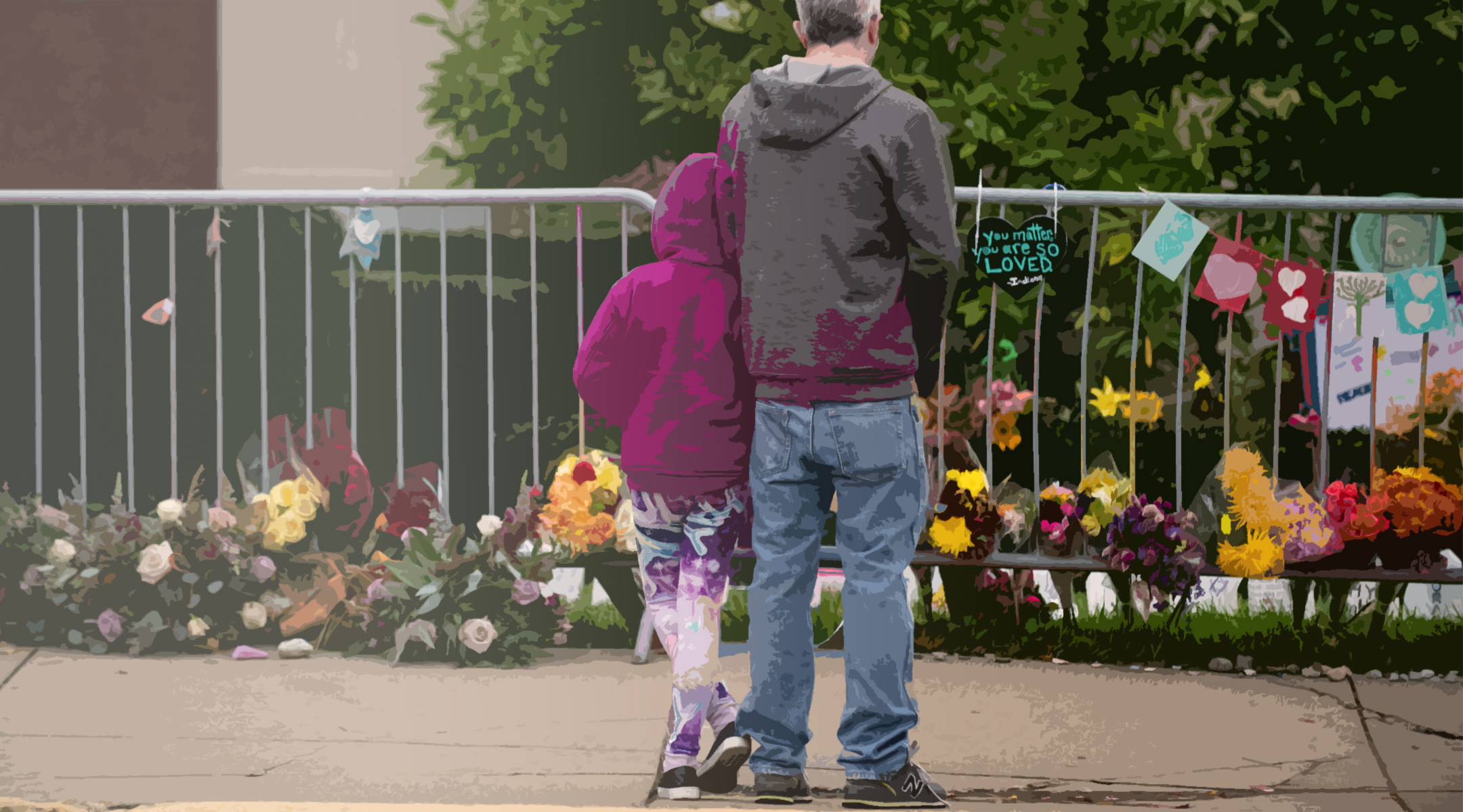 Visitors look at items well-wishers have left behind along the fence at the Tree of Life Synagogue on the 1st Anniversary of the attack on October 27, 2019 in Pittsburgh, Pennsylvania. (Photo/JTA-Jeff Swensen-Getty Images)