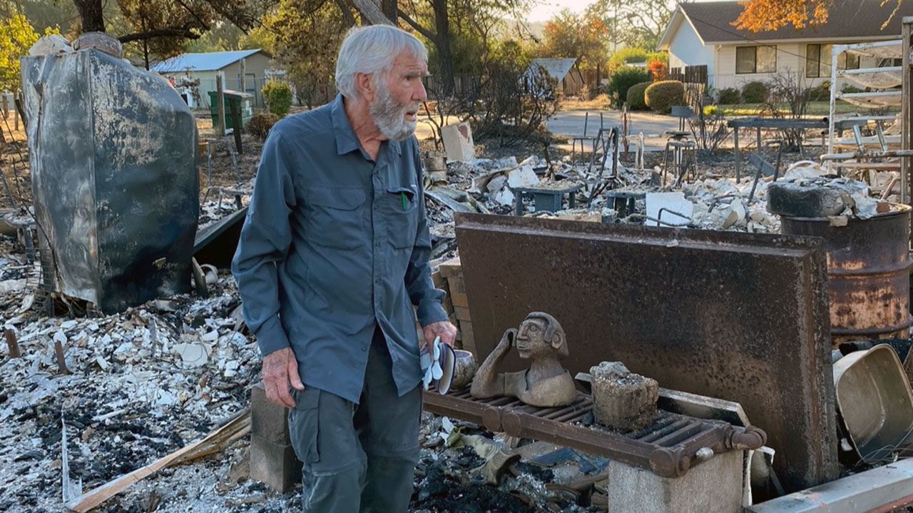 Wayne Reynolds looks through the rubble of the home and studio he shared with his wife, Caryn Fried. (Photo/Courtesy Maya Reynolds)
