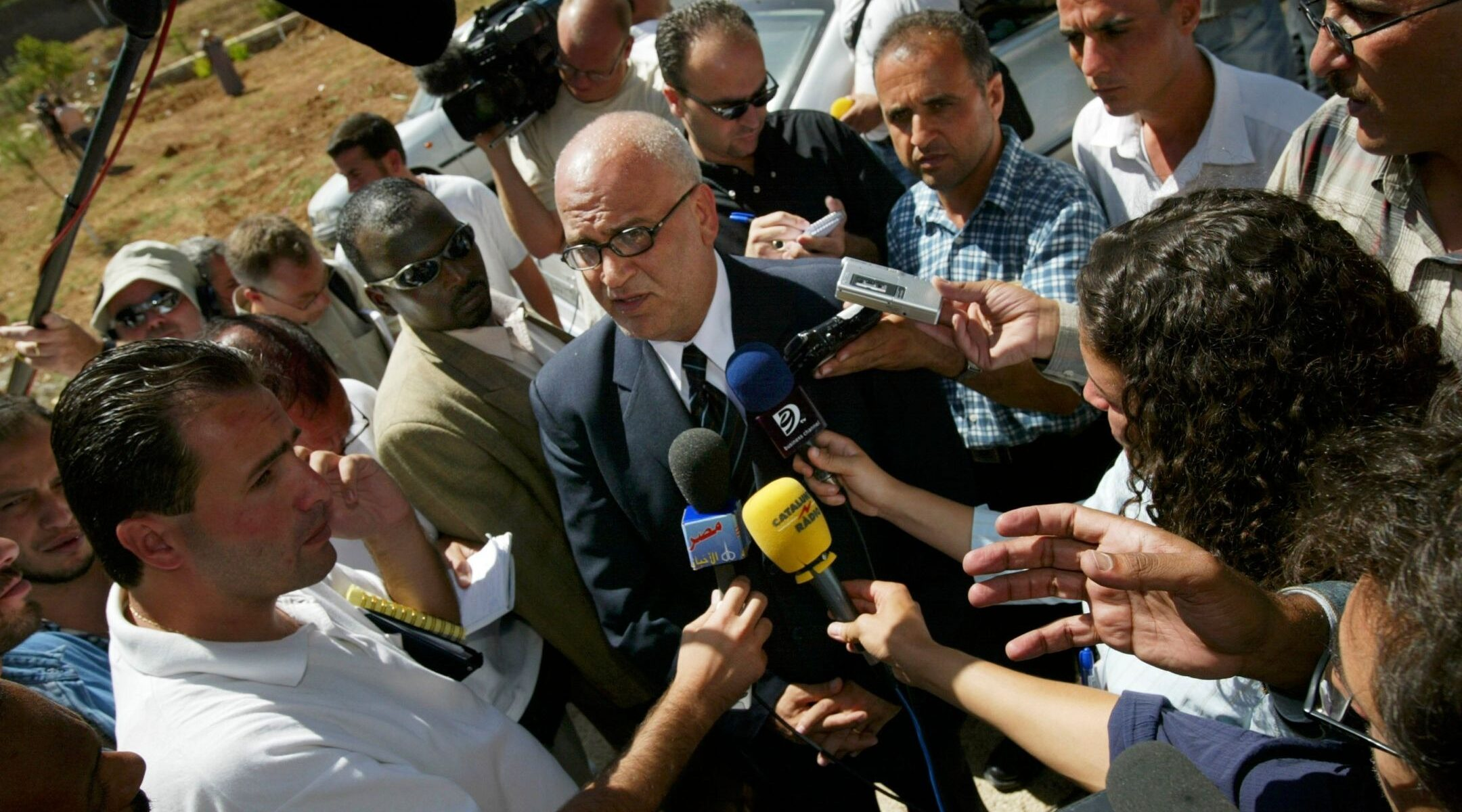 Palestinian Authority parliament member Saeb Erekat talks with the press before a meeting at the Palestinian parliament in Ramallah, Sept. 6, 2003. (Photo/JTA-Paula Bronstein-Getty Images)