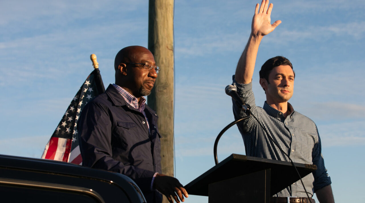 Democratic Senate candidates Rev. Raphael Warnock (left) and Jon Ossoff greet supporters during a rally in Marietta, Georgia, Nov. 15, 2020. (Photo/JTA-Jessica McGowan-Getty Images)