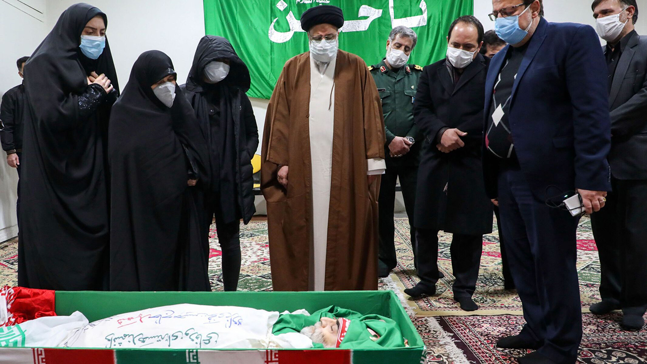 Iran's judiciary chief, Ayatollah Ebrahim Raisi (center) pays respects to the body of slain scientist Mohsen Fakhrizadeh among his family in Tehran, Nov. 28, 2020. (Photo/JTA-Mazan News Agency-AFP via Getty Images)