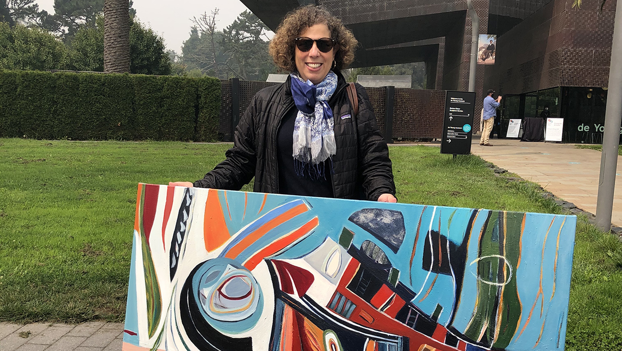 Merl Ross in front of the de Young with one of her artworks that is currently on display in the de Young Open.