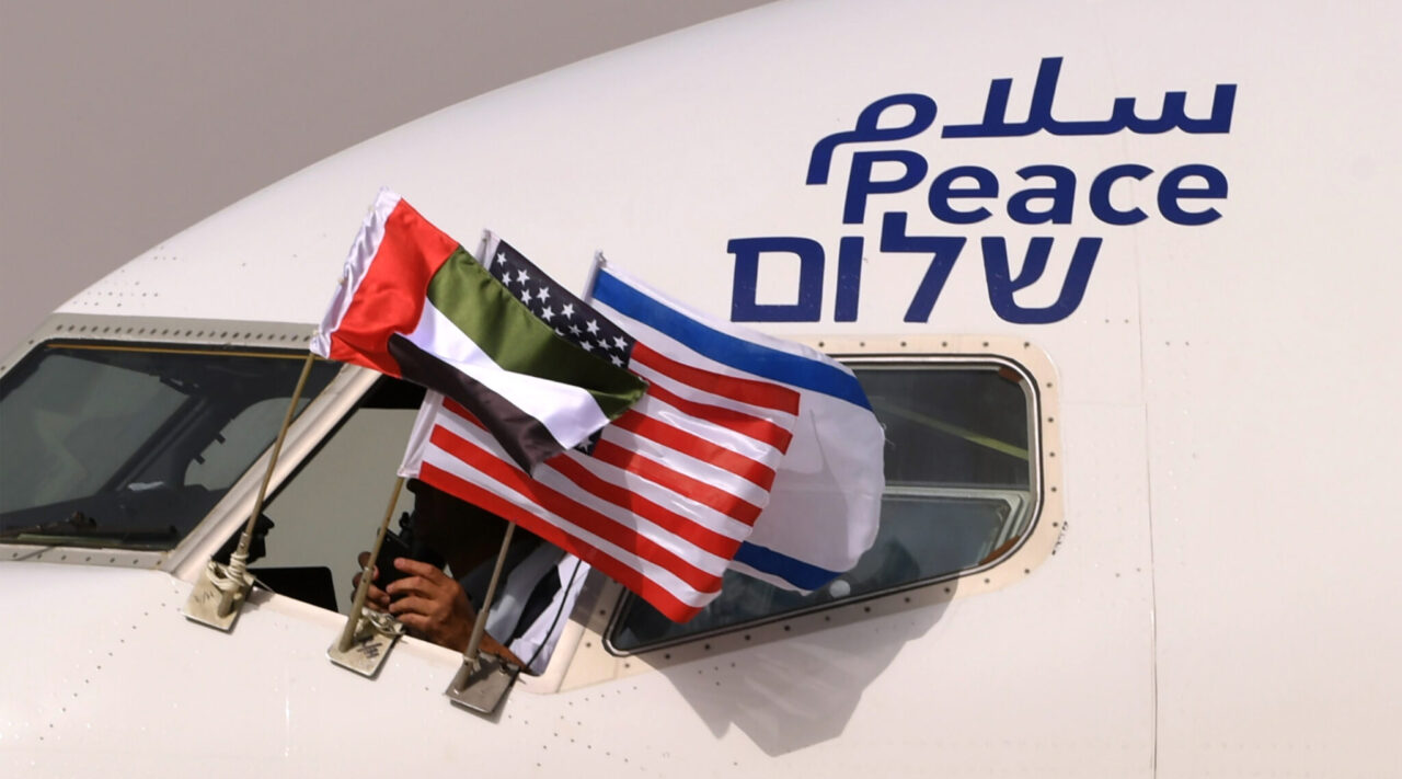 "An El Al plane flying the flags of Israel, the United Arab Emirates and the United States, and bearing the word ""peace"" in Arabic, English and Hebrew, arrives at the Abu Dhabi airport from Tel Aviv, Aug. 31, 2020. (Photo/JTA-Karim Sahib-AFP via Getty Images)"