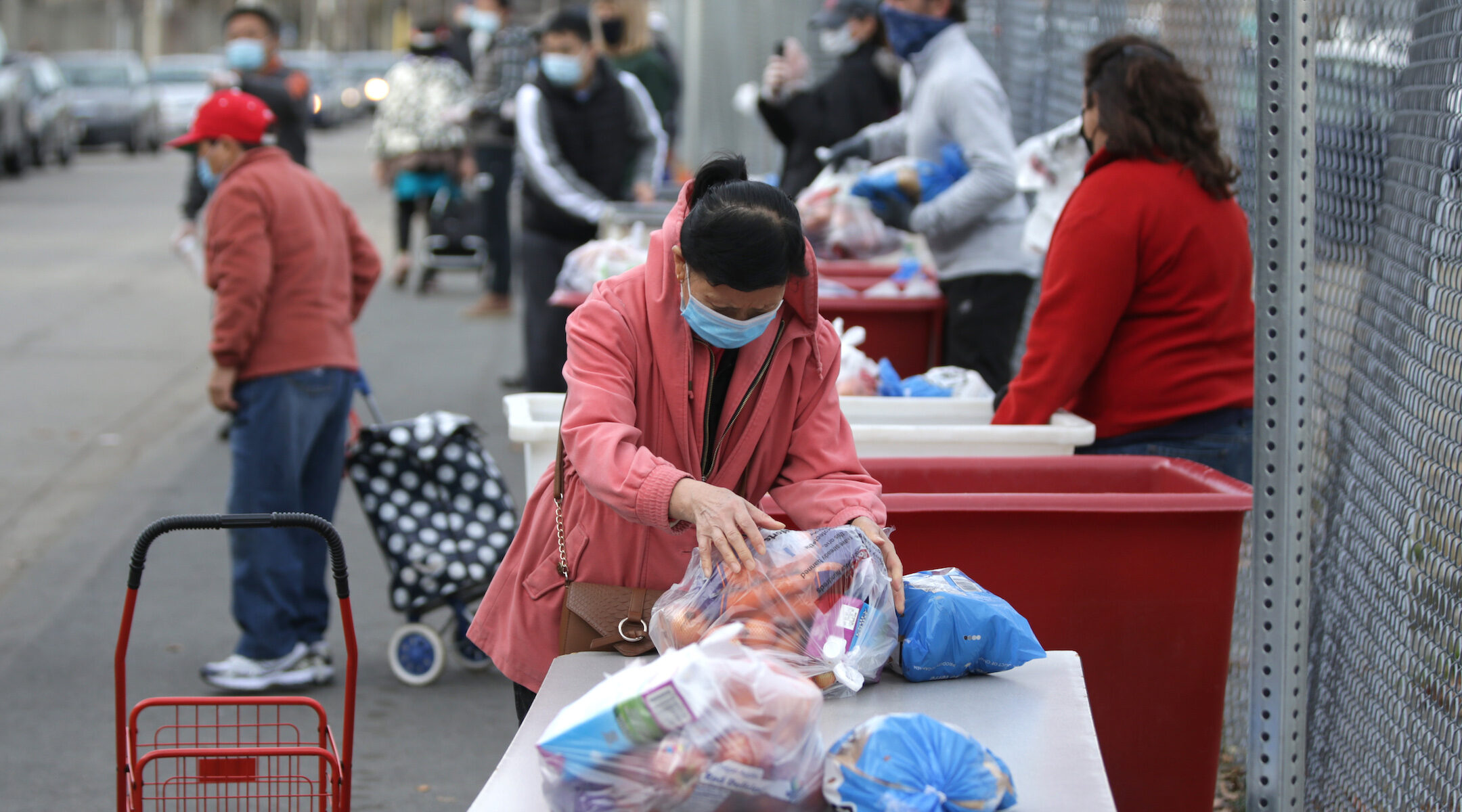 A person picks up donated produce at the American Red Cross food pantry in Boston during Thanksgiving meal distribution, Nov. 21, 2020. (Photo/JTA-Jonathan Wiggs-The Boston Globe via Getty Images)