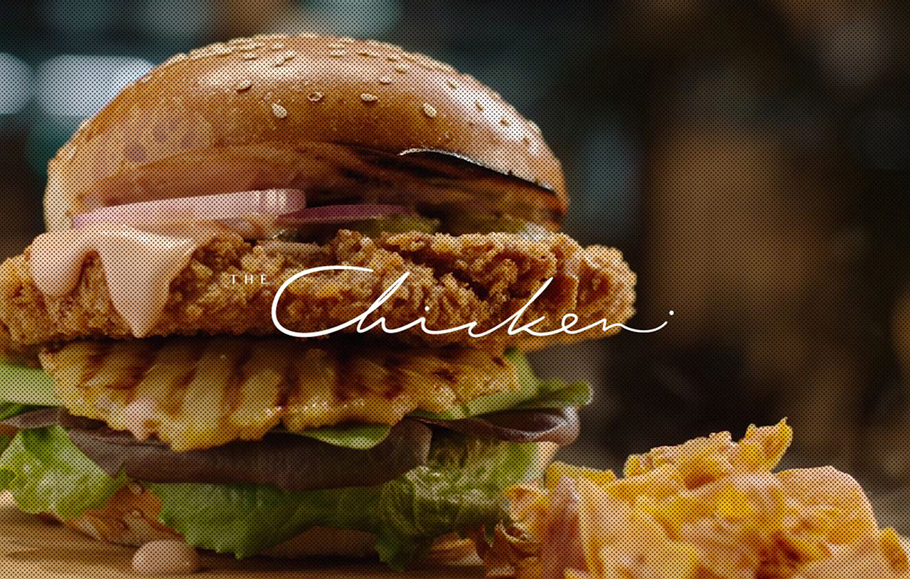 A chicken burger advertised on the website for The Chicken, a restaurant that serves lab-grown meat in Nes Tziona, Israel. (Screenshot/JTA)