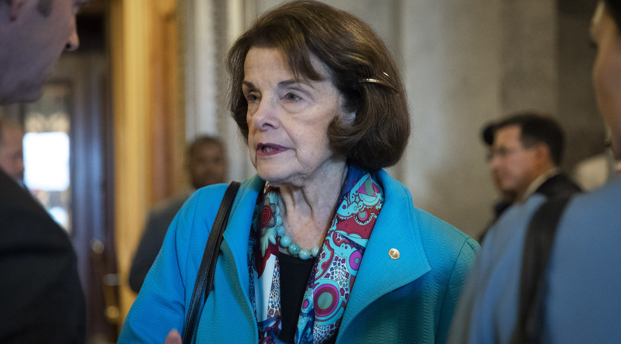 Dianne Feinstein talks to reporters as she exits the Senate floor, Oct. 6, 2018. (Photo/JTA-Drew Angerer-Getty Images)