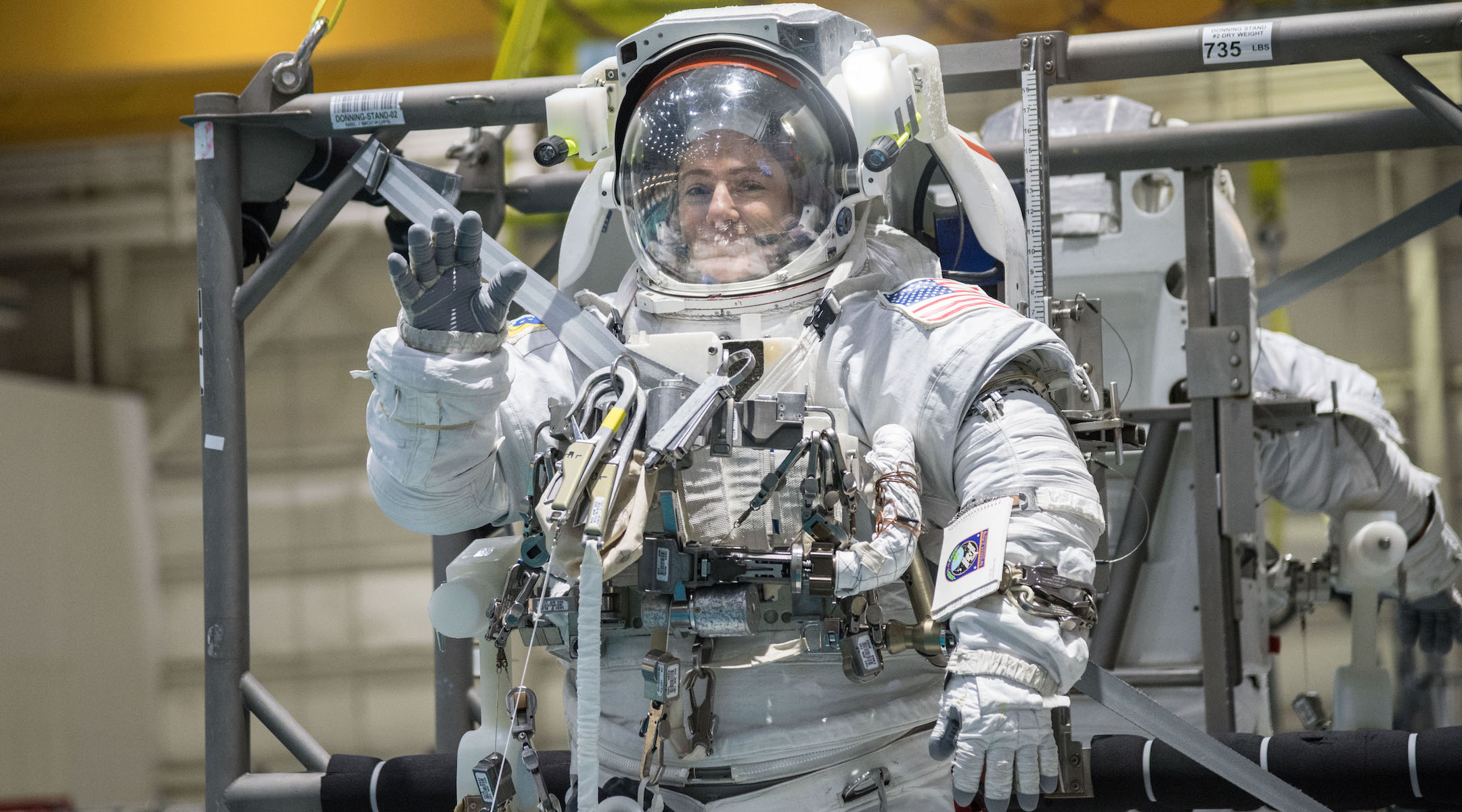 Jessica Meir prepares to be submerged in NASA's 6.2 million gallon Neutral Buoyancy Laboratory for spacewalk training. (Photo/JTA-NASA-Josh Valcarcel)