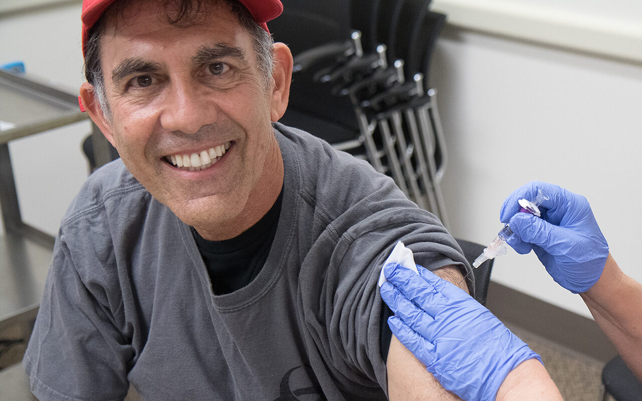 Stanford virologist Dr. Robert Siegel, seen here getting a flu shot, caught our readers' attention earlier this year with his Covid vaccine straight-talk. (Photo/Courtesy Siegel)