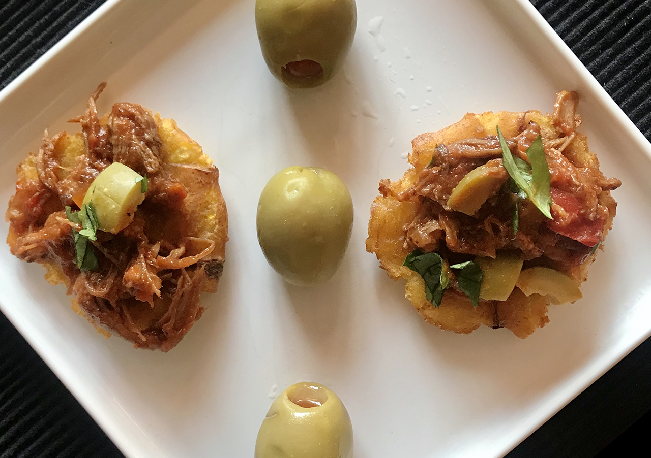 Smashed fried plantains topped with Cuban-style pot roast make a perfect Hanukkah appetizer. (Photo/Faith Kramer)