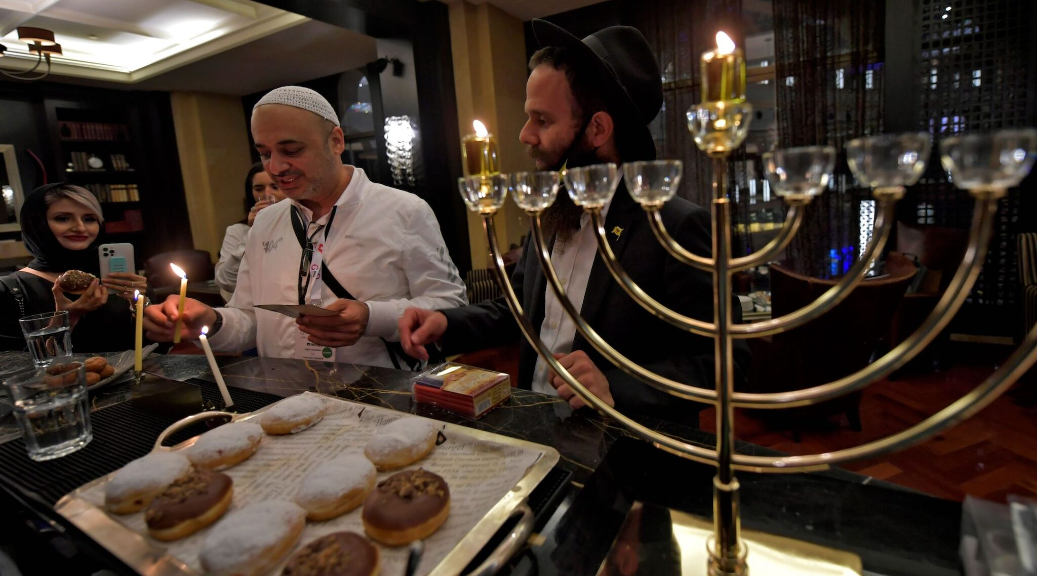 Israelis celebrate Hanukkah at a hotel in Dubai, Dec. 10, 2020. (Photo/JTA-Karim Sahib-AFP via Getty Images)