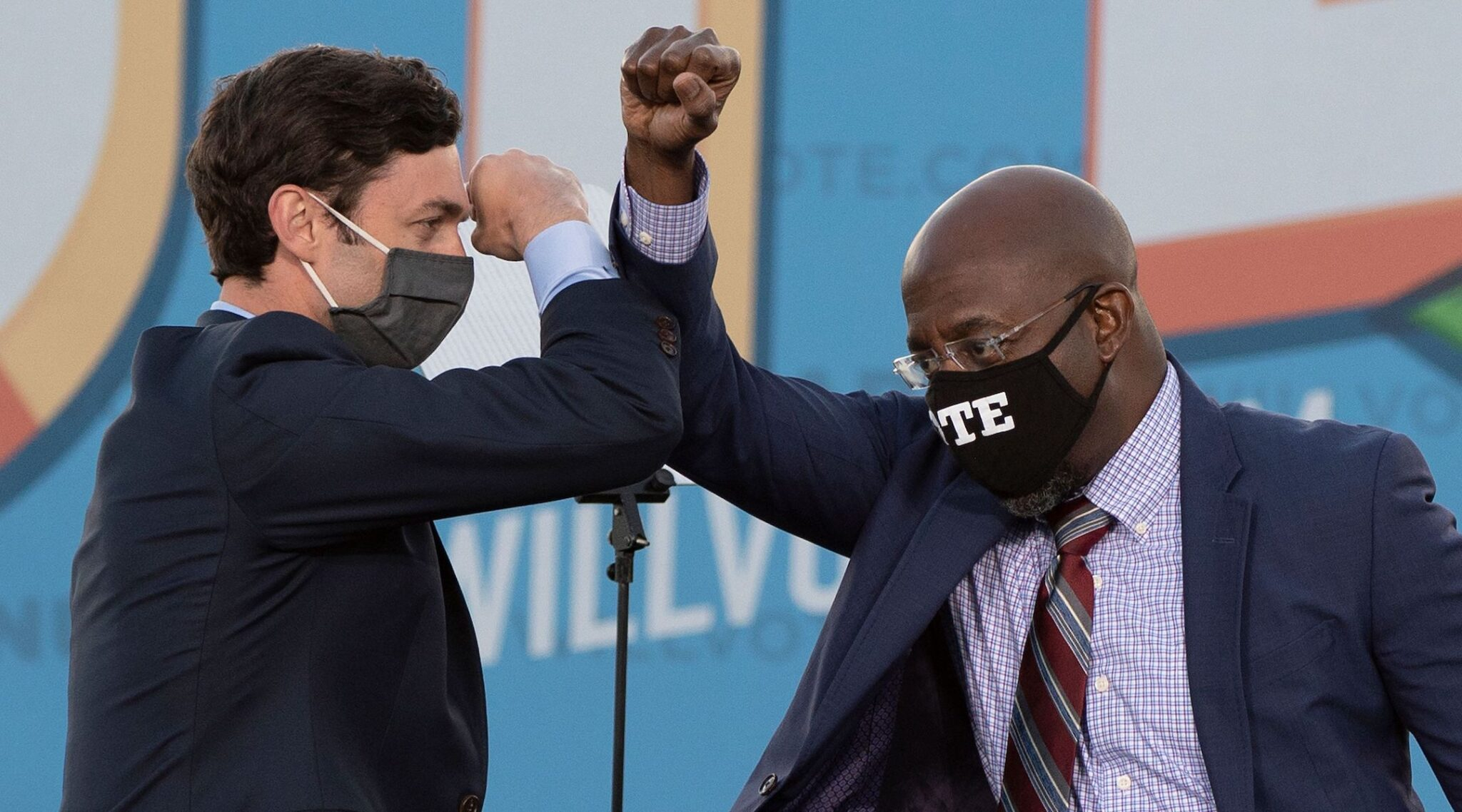 Jon Ossoff and Rev. Raphael Warnock bump elbows on stage during a rally with President-elect Joe Biden outside Center Parc Stadium in Atlanta, Jan. 4, 2021. (Photo/JTA-Jim Watson-AFP via Getty Images)
