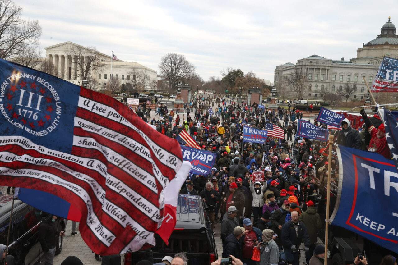 """A flag reading """"when tyranny becomes law, rebellion becomes duty"""" and bearing the logo of the Three Percenters on display amid the Washington rioting, Jan. 6, 2021. (Photo/JTA-Tasos Katopodis-Getty Images)"""