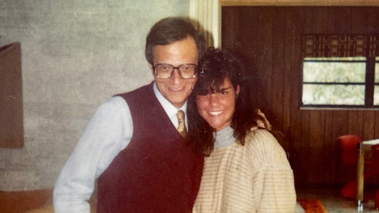 Tiffany Woolf with longtime family friend Larry King.