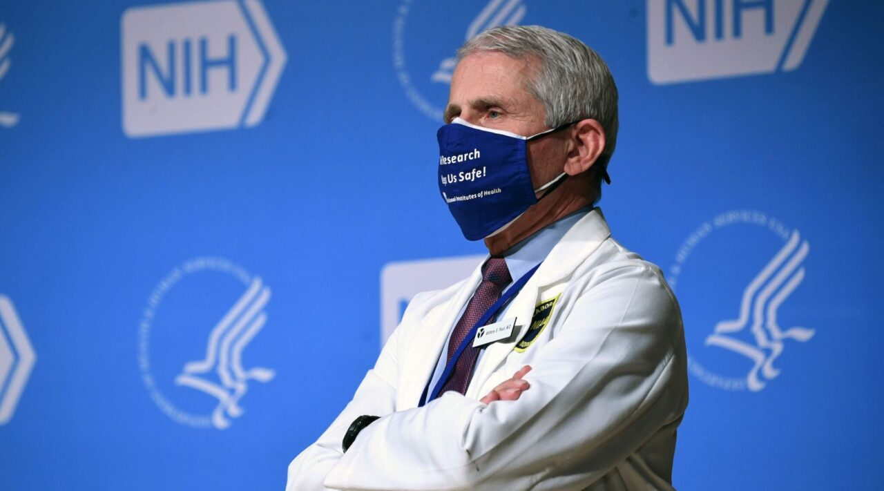 Dr. Anthony Fauci listens to President Joe Biden at the National Institutes of Health, Feb. 11, 2021. (Photo/JTA-Saul Loeb-AFP via Getty Images)