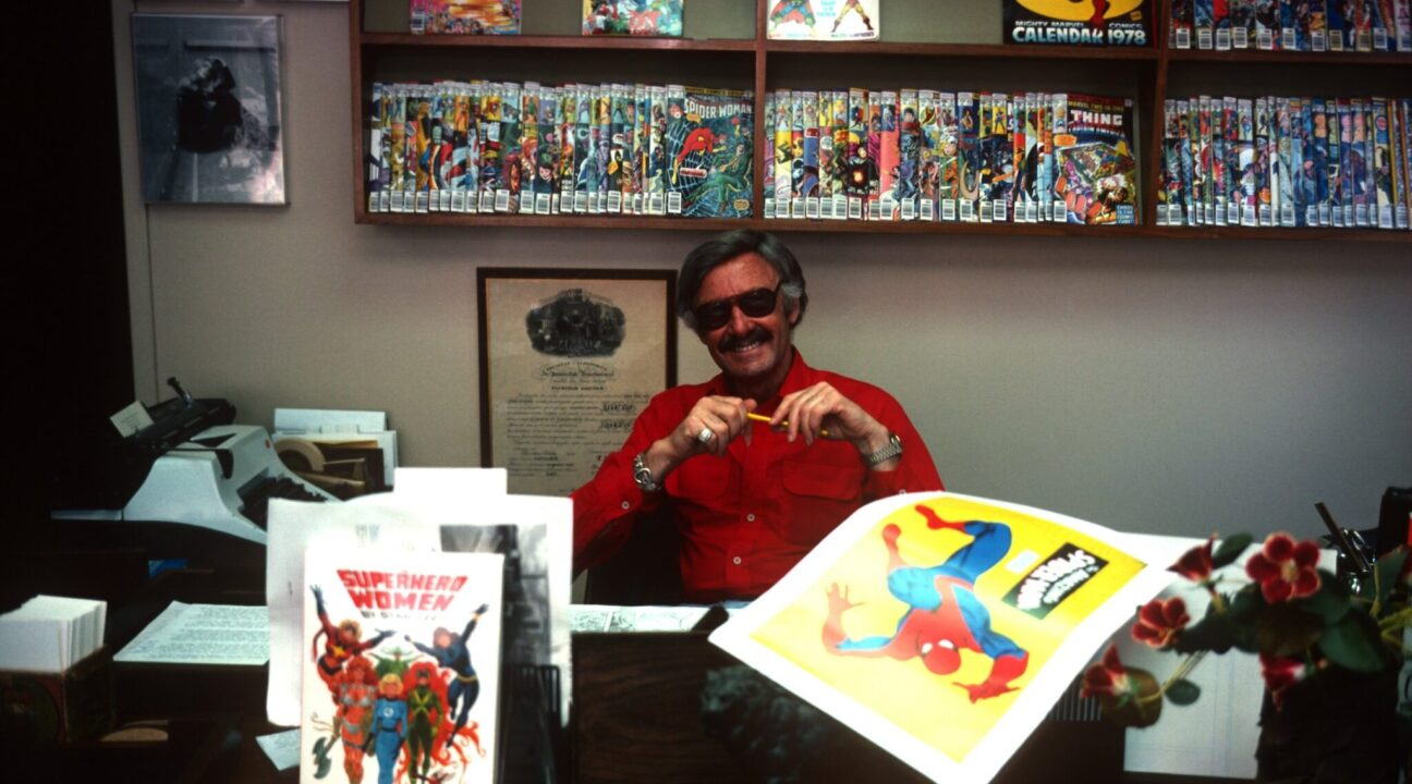 Stan Lee with racks of Marvel comics in New York, June 15, 1978. (Photo/JTA-Santi Visalli-Getty Images)