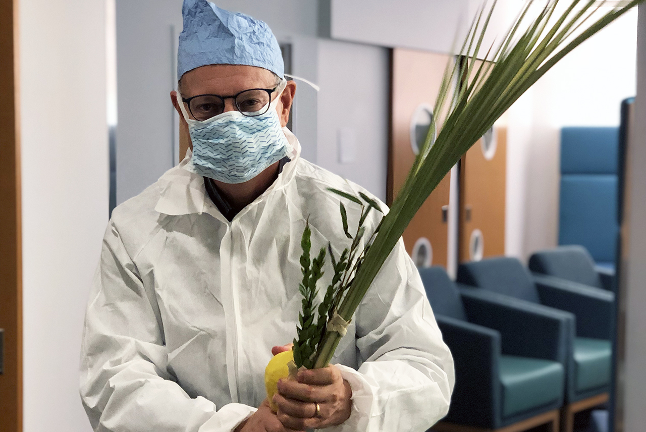 Dr. Bruce Feldstein, a chaplain at Stanford Medicine, on his way to meet with a newborn's family during Sukkot.