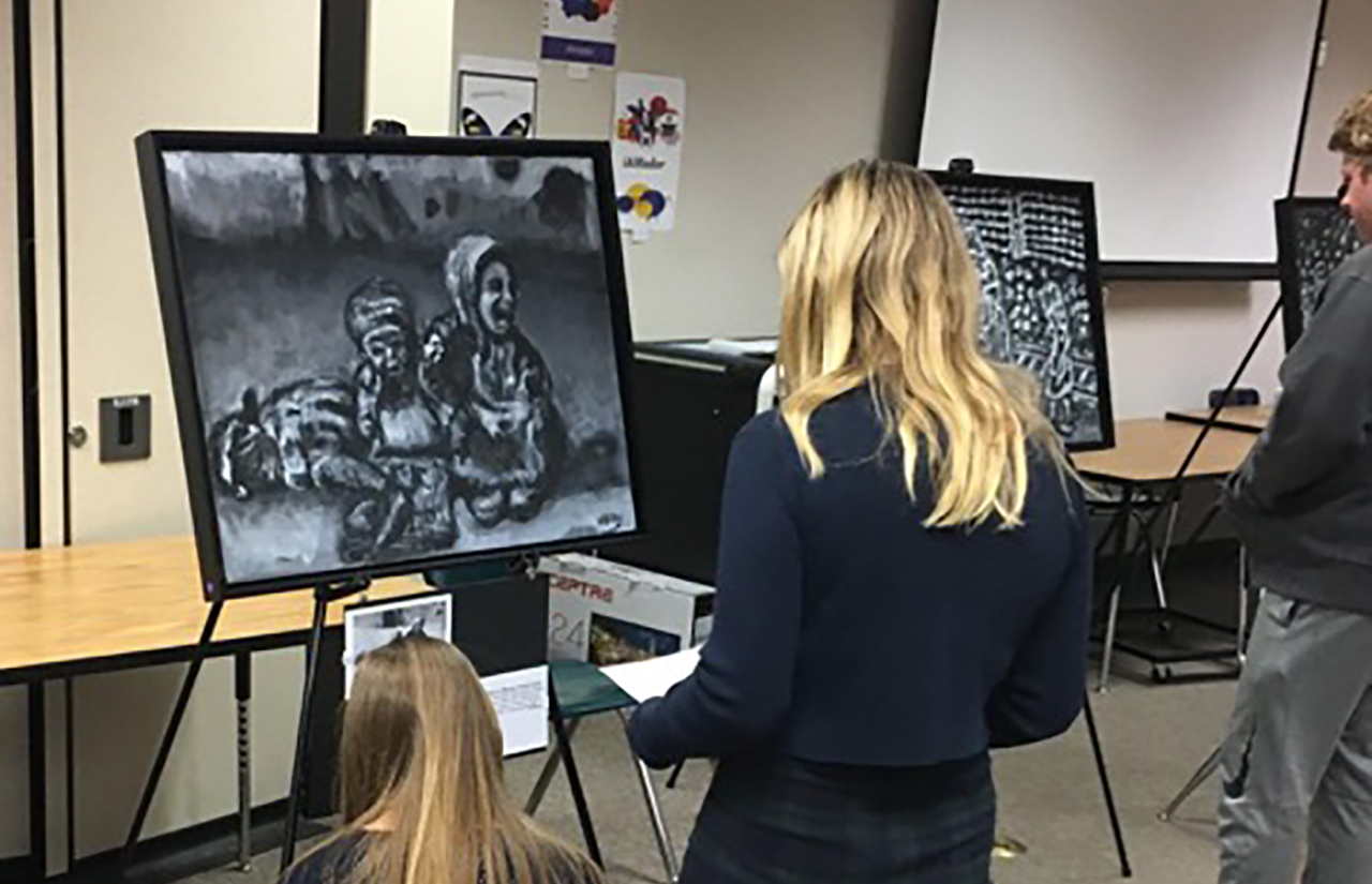Students at Amador Valley High School in Pleasanton look at art from the center in March 2020.