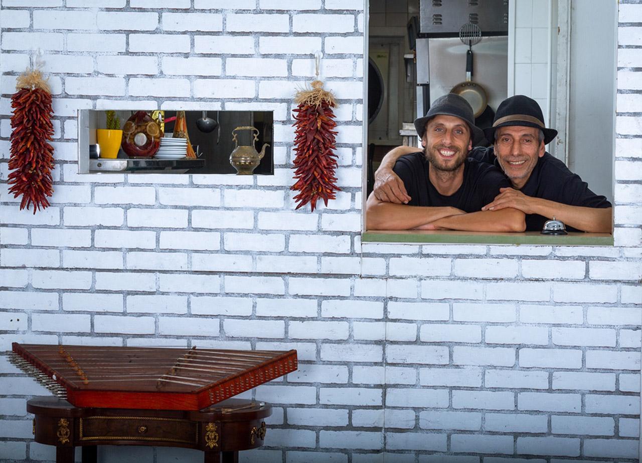 Eitan Hilleli (right) with his son Joseph at Sabra Grill.