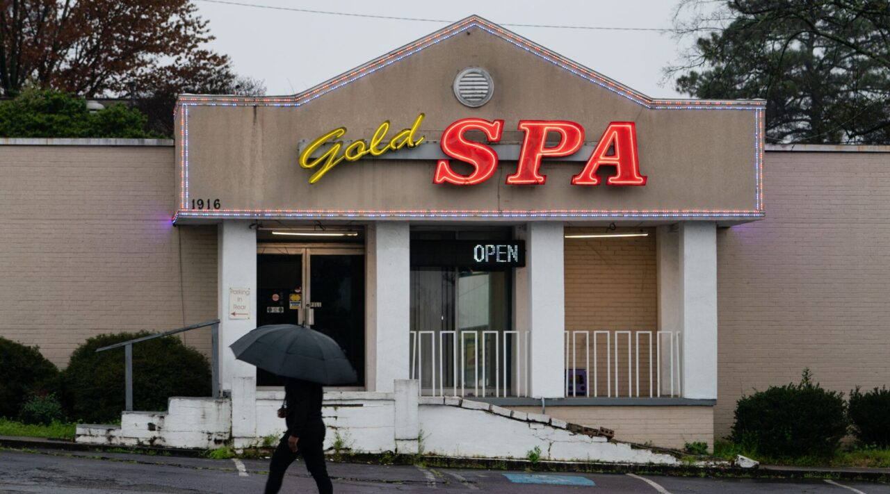A man walks past a massage parlor where three women were shot and killed in Atlanta, March 17, 2021. (Photo/JTA-Elijah Nouvelage-Getty Images)