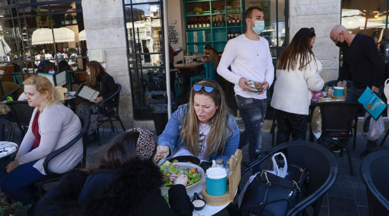 People eat at the Hamotzi restaurant in Jerusalem, on March 7, 2021, after Israel reopened restaurants, bars and cafes to those who have been vaccinated. (Photo/JTA-Menahem Kahana-AFP via Getty Images)