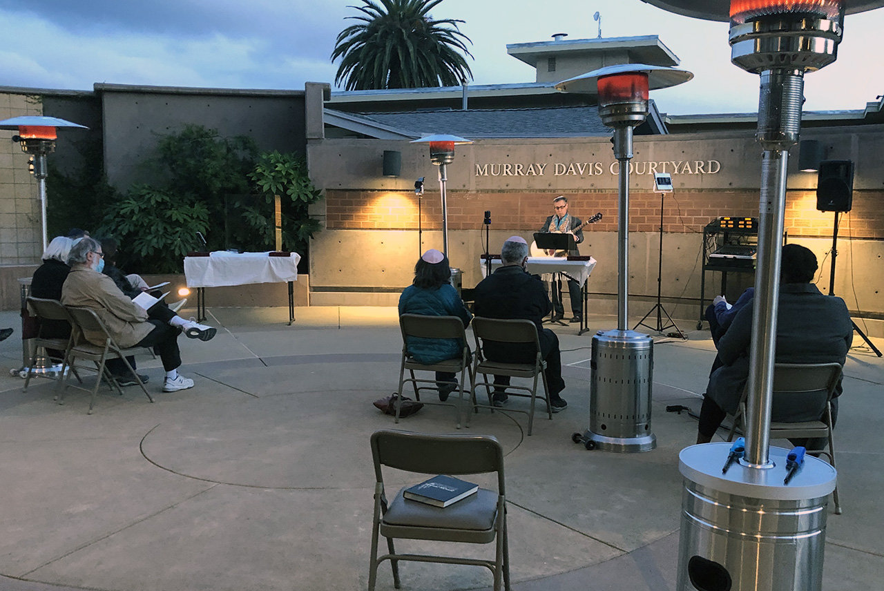 Rabbi Mark Bloom leads a socially distanced outdoor Friday night service at Temple Beth Abraham in Oakland, March 5, 2021. (Photo/Gabe Stutman)