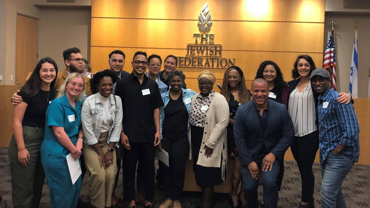The Jews of Color Initiative's Ilana Kaufman (blue shirt and glasses, seventh from left) and Angel Alvarez-Mapp (black shirt and glasses, sixth from left) meet with Jewish community leaders at the Jewish Federation of Greater Los Angeles.