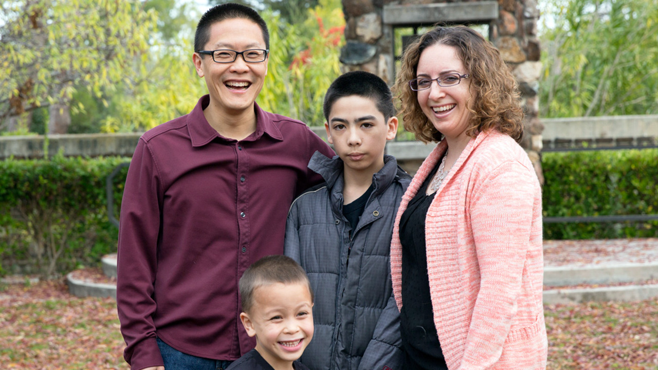 Andy Cheng (left) with his wife and their sons.