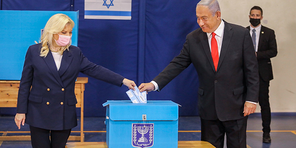 Israeli Prime Minister Benjamin Netanyahu and his wife, Sara, vote in Jerusalem on March 23, 2021. (Photo/JTA-Marc Israel Sellem-Flash90)