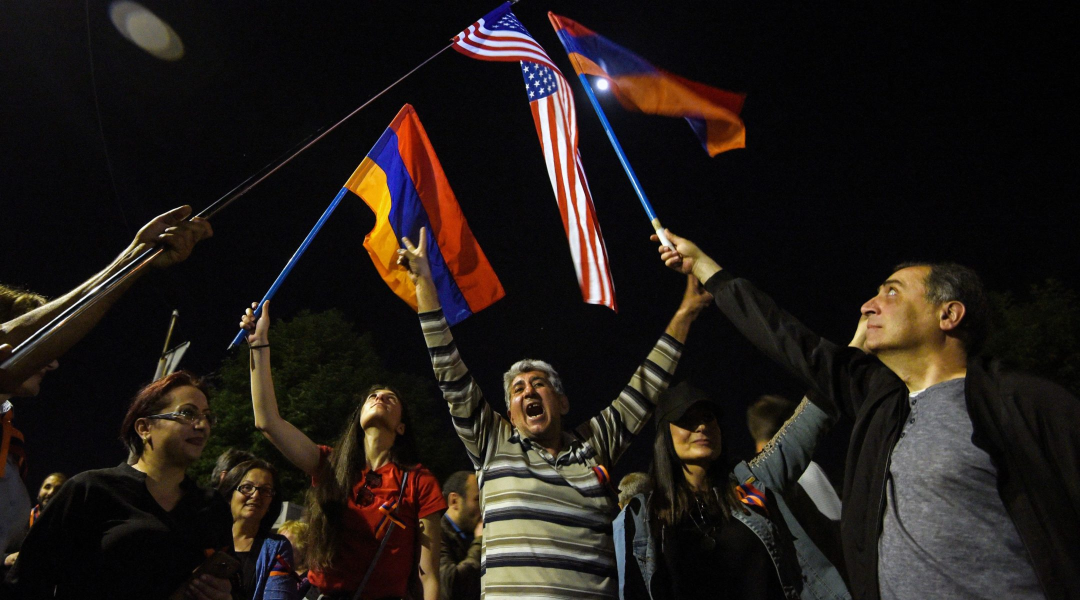 People wave Armenian and U.S. flags in front of the U.S. Embassy in the Armenian capital Yerevan after President Joe Biden recognized the 1915 killings of Armenians by Ottoman forces as genocide, April 24, 2021. (Photo/JTA-Karen Minasyan-AFP via Getty Images)