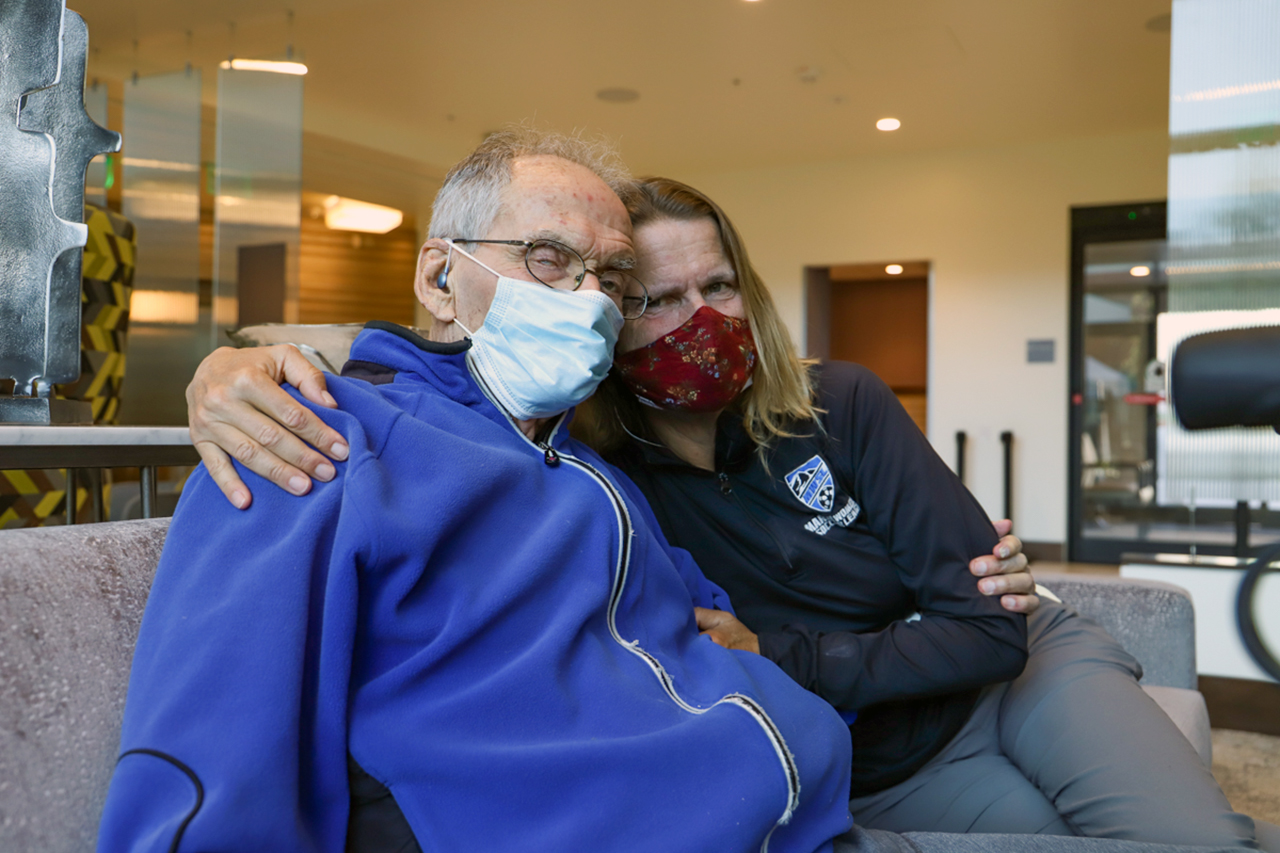 Susan Aronovsky visits with her 94-year-old father, Albert Stark, at the S.F. Campus for Jewish Living on March 29. (Photo/Camille Cohen)