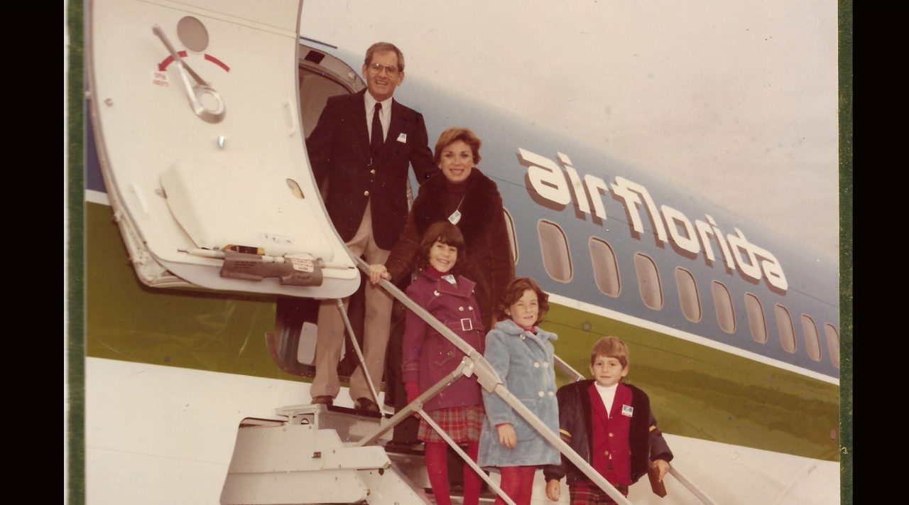 Eli Timoner stands with his family, including future rabbi Rachel Timoner, on a plane from the airline he founded.