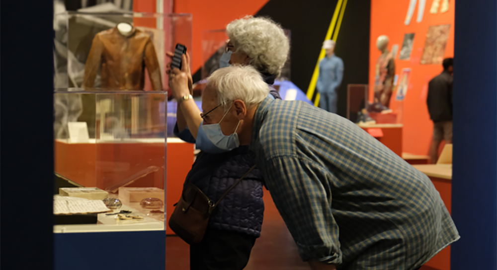"""Vic and Linda Milhoan explore """"Levi Strauss: A History of American Style"""" at the Contemporary Jewish Museum in San Francisco. (Photo/Forward-Sarah Brown)"""