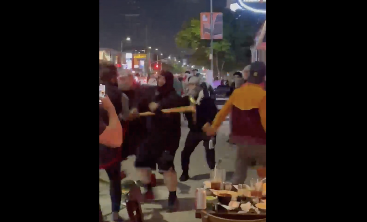 Pro-Palestinian demonstrators are captured on cellphone video physically attacking Jews and using antisemitic language at a restaurant in Los Angeles, May 18, 2021. (Screenshot/Twitter @AdamMilstein)