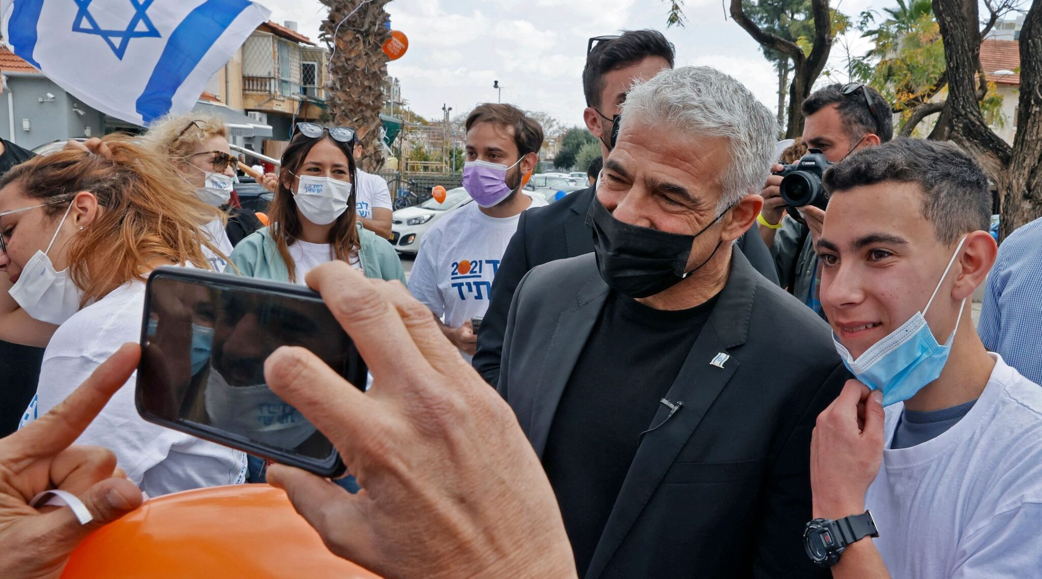 Yair Lapid campaigning in the Israeli city of Hod Hasharon in March (Photo/Jack Guez-AFP via Getty Images)