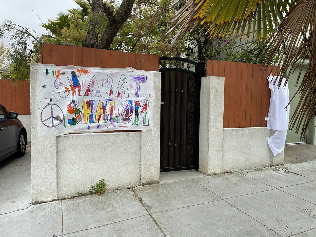 Following the appearance of anti-Israel graffiti at Gan Noe Preschool, the children decorated a banner offering Shabbat greetings to the neighborhood.