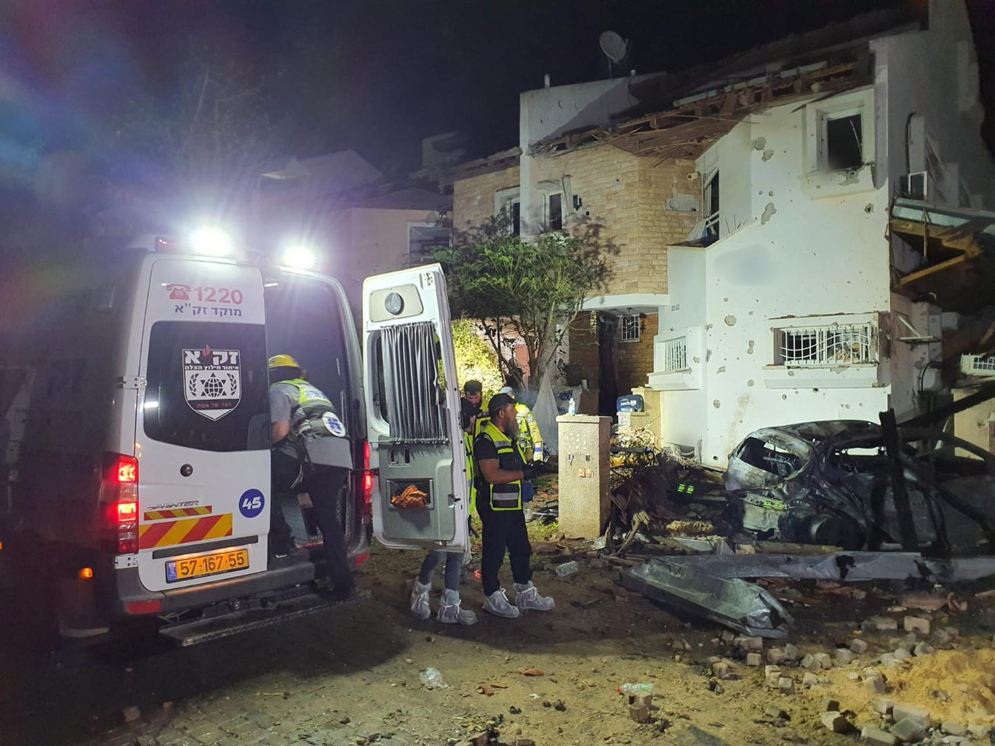 An Israeli emergency crew at the site of a rocket attack in Rishon Lezion that left one person dead. (Photo/Courtesy ZAKA)