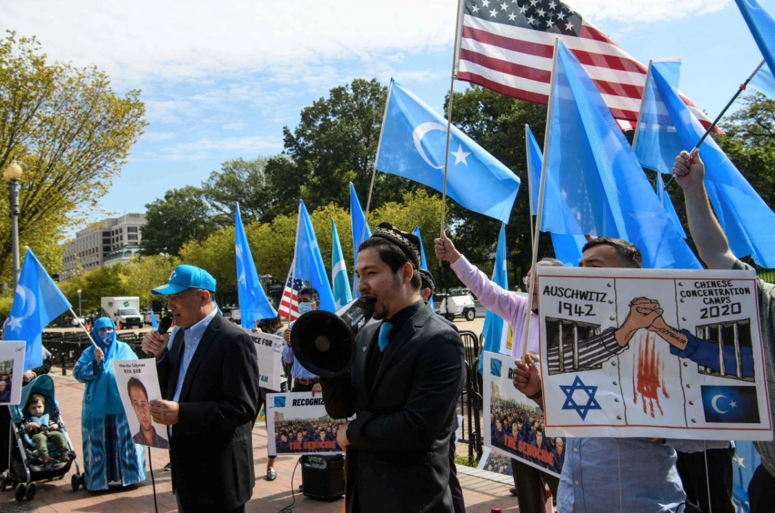 Salih Hudayar (center, with bullhorn), the prime minister of the East Turkistan government-in-exile, leads a protest in Washington, D.C. (Photo/Courtesy)