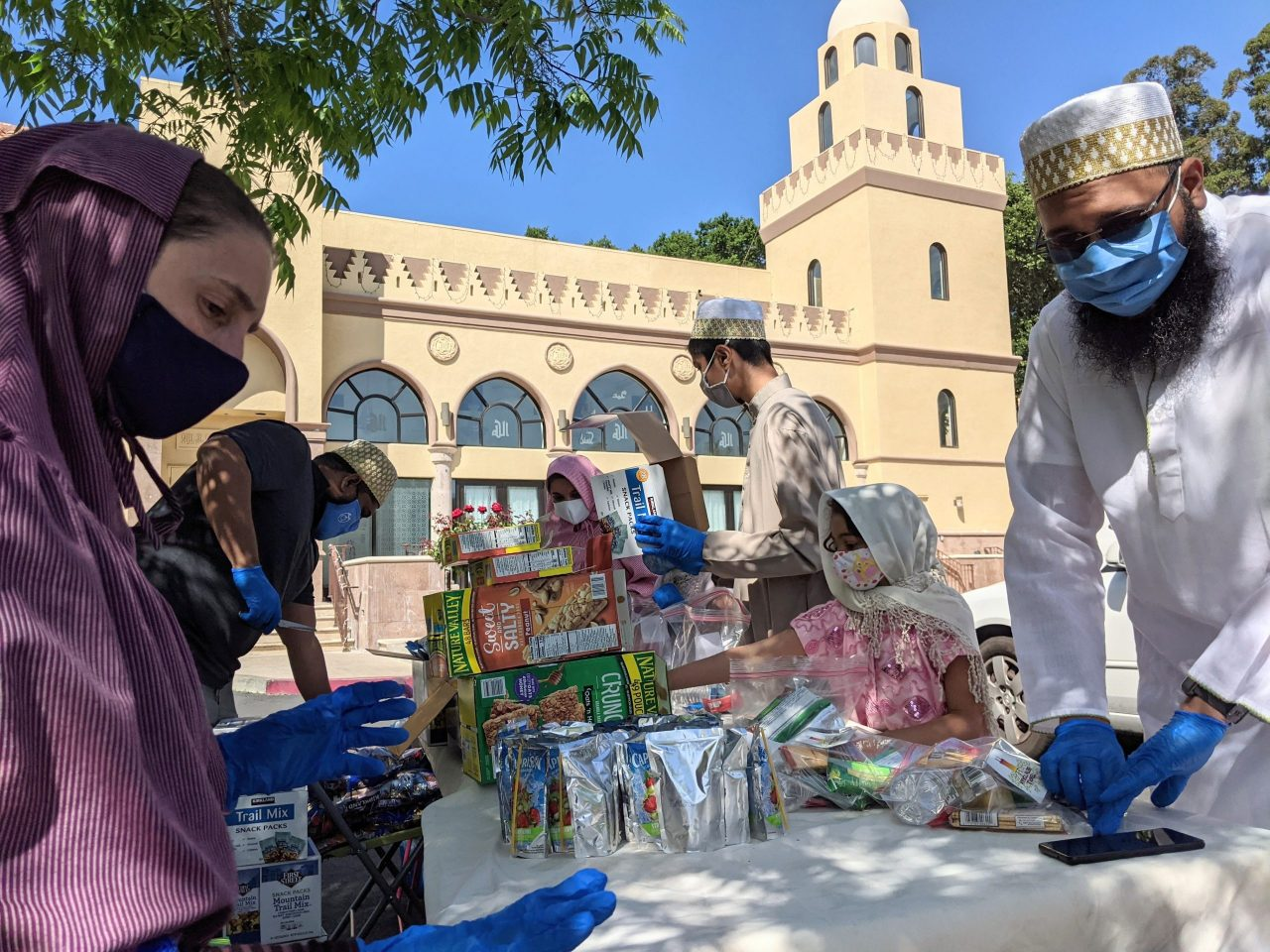 Muslim volunteers assemble snack and hygiene packs at Masjid-e-Mohammedi in Fremont, part of a day of cooperation between the mosque and Temple Beth Torah, May 2021. (Photo/Mufaddal Ezzy)