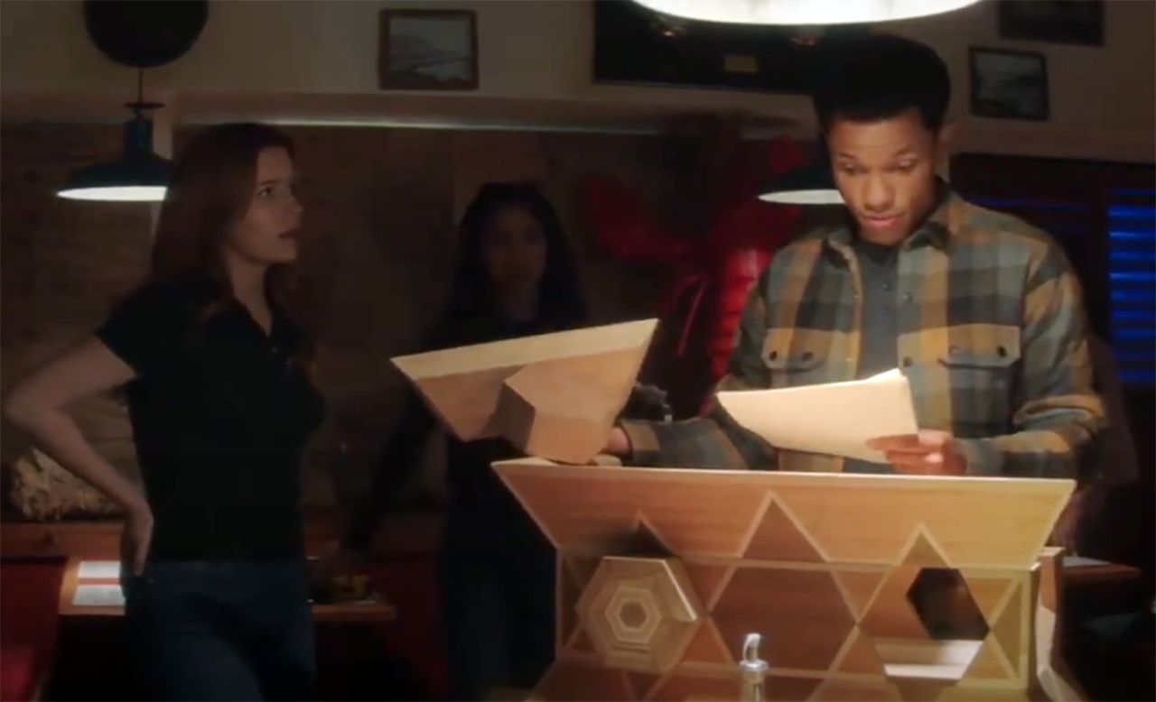 """The gang assesses a counterfeit """"dybbuk box"""" on the CW series """"Nancy Drew."""" (Screenshot)"""