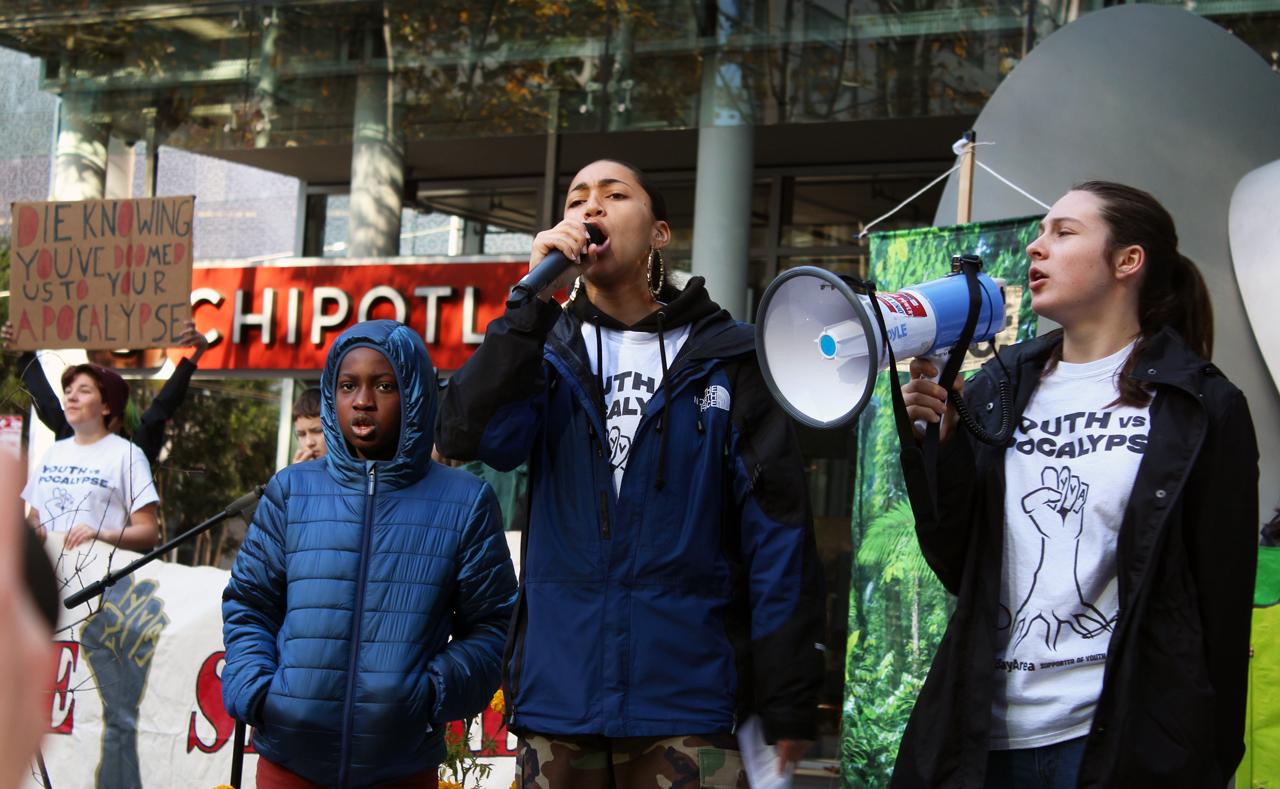 Isha Clarke (center), then a high school senior, emcees a Youth vs. Apocalypse protest in San Francisco, Dec. 6, 2019. (Photo/Gabriel Greschler)